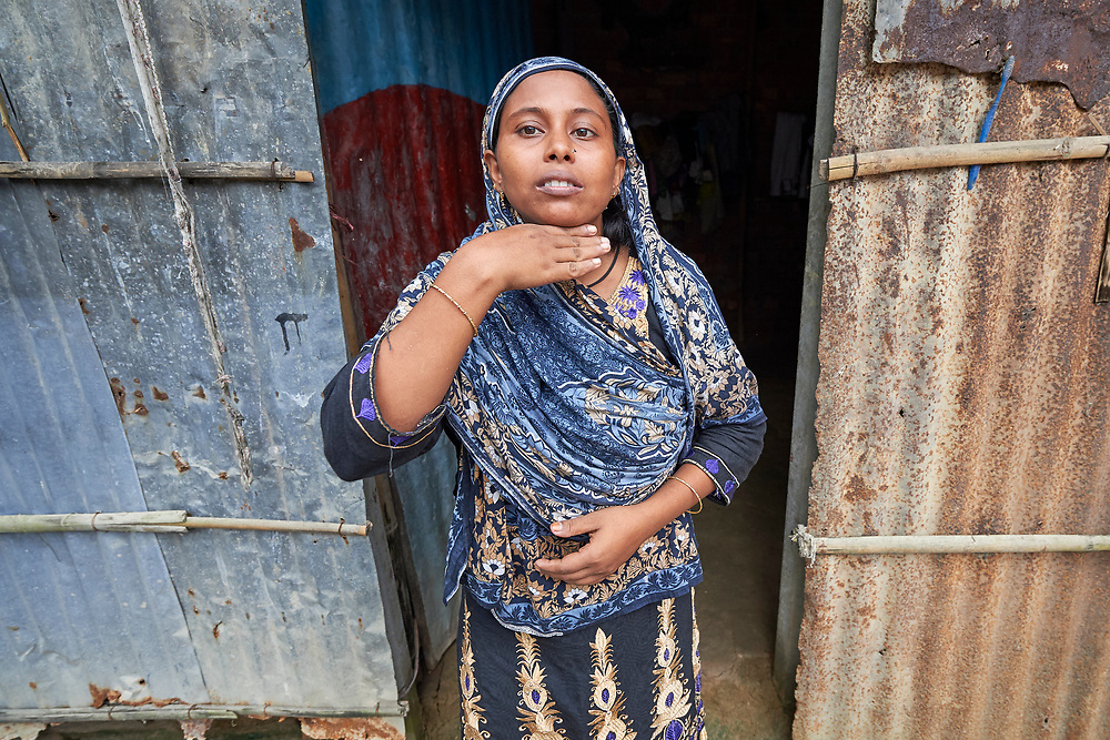 Rehena Akter shows the level to which August 2017 floods rose in Suihari in northern Bangladesh. The devastating floods affected thousands of families across the region, and Akter and her family lost their home. Today they live with a neighbor, and she's hopeful she can soon borrow the money from a local savings group in order to start construction of her own home.<br /> <br /> While families in the area were still displaced by high waters, Christian Aid and the Christian Commission for Development Bangladesh, both members of the ACT Alliance, worked together to provide emergency food packages to vulnerable residents, including Akter and her family.