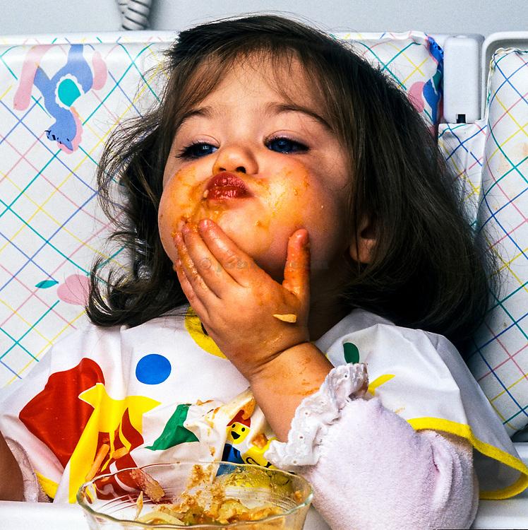 Toddler making a food mess.