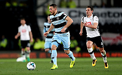 Conor Washington of Queens Park Rangers goes past Craig Bryson of Derby County - Mandatory by-line: Robbie Stephenson/JMP - 31/03/2017 - FOOTBALL - iPro Stadium - Derby, England - Derby County v Queens Park Rangers - Sky Bet Championship