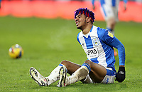 Huddersfield Town's Juninho Bacuna grimaces as he is left grounded following a challenge<br /> <br /> Photographer Rich Linley/CameraSport<br /> <br /> The EFL Sky Bet Championship - Saturday 2nd January 2021 - Huddersfield Town v Reading - The John Smith's Stadium - Huddersfield<br /> <br /> World Copyright © 2020 CameraSport. All rights reserved. 43 Linden Ave. Countesthorpe. Leicester. England. LE8 5PG - Tel: +44 (0) 116 277 4147 - admin@camerasport.com - www.camerasport.com