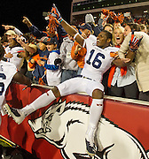 Auburn linebacker JaViere Mitchell (16) celebrates with the crowd<br /> following an NCAA college football game against Arkansas in Fayetteville, Ark., Saturday, Nov. 2, 2013. Auburn defeated Arkansas 35-17. (AP Photo/Beth Hall)