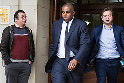 London, UK. 9th April 2019. David Lammy, Labour MP for Tottenham, leaves the People's Vote rally in Westminster.