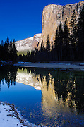 Morning light on El Capitan from the Merced River in winter, Yosemite National Park, California USA