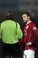 Photo: Olly Greenwood.<br />Southend United v Manchester United. Carling Cup. 07/11/2006. Manchester United's Wayne Rooney is booked by referre Mr U Rennie