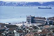 View over historic buildings and River Tagus, Commerce Square, Praça do Comércio, Terreiro do Paço, Lisbon, Portugal, 1975