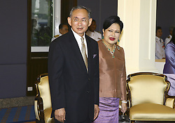 Thailand's King Bhumibol Adulyadej (L) arrives at the Royal Navy Club with Queen Sirikit (R) to attend the Royal Barge Procession on June 12, 2006 in Bangkok, Thailand. The king of Thailand is marking the 60th anniversary of his accession to the throne. Photo by Patrick Durand/ABACAPRESS.COM    99795_55