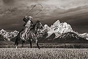 Wrangler and horse in front of the Grand Teton mountain range in Jackson Hole, WY