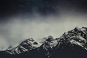 Patches of snow on a cloudy day in the Italian Alps - textured photograph<br /> Society6 products: https://society6.com/product/misty-dark-mountains_print#1=45