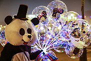 People wearing Christmas and New Year Eve themed outfit carrying helium blown balloons are gathering together for a final round in the nearly empty capital city of Armenia, Yerevan on Friday, Jan 1, 2021. (Photo/ Vudi Xhymshiti)