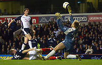 Robbie Keane of Tottenham Hotspur lifts the ball over Tomasz Kuszczak of West Bromwich Albion to score the equalising goal.