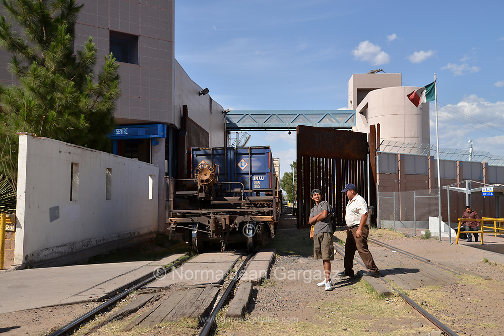 A train hauling mostly manufactured automobiles stops in Nogales, Sonora, Mexico, to be processed before entering a metal gate at the Dennis DeConcini Port of Entry to enter the United States at Nogales, Arizona.