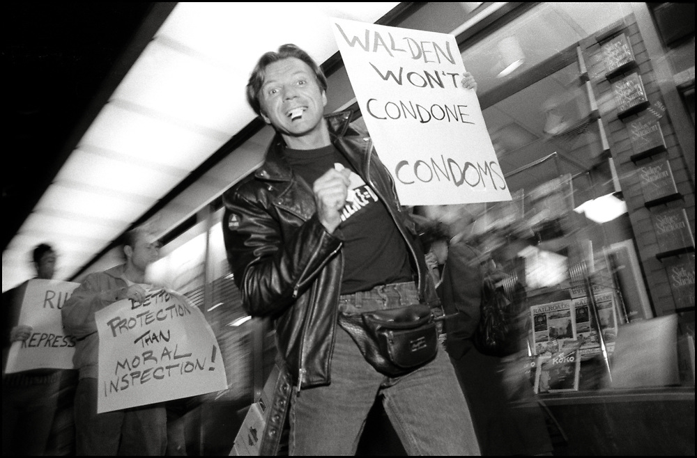"""In November of 1988, ACT UP protested outside of a Waldenbooks in New York City after the chain pulled copies of the November Issue of Spin Magazine, which included a free condom inside, off of their shelves and refused to sell it. <br /> <br /> The issue featured a public service announcement that included the condom and instructions on how to use condoms.<br /> <br /> """"The condom is the magazine's way of making a statement about the deadly AIDS virus, and is telling readers to subscribe to safe sex,"""" according to a statement released by Spin editor and publisher Bob Guccione Jr.<br /> <br /> Jeff Griglak of ACT UP pictured here."""