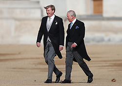 King Willem-Alexander of the Netherlands (left) accompanied by His Royal Highness The Prince of Wales inspects the Guard of Honour formed of the 1st Battalion Coldstream Guards on Horse Guards Parade during his first state visit to the United Kingdom in London. Picture date: Tuesday October 23rd 2018. Photo credit should read: Chris Radburn/EMPICS Entertainment