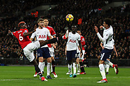 Paul Pogba of Manchester Utd (l) stretches to reach the ball ahead of Dele Alli of Tottenham Hotspur ®. Premier league match, Tottenham Hotspur v Manchester Utd at Wembley Stadium in London on Wednesday 31st January 2018.<br /> pic by Steffan Bowen, Andrew Orchard sports photography.