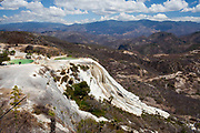 Hierve el agua is a natual geological formation in Oaxaca, Mexico. It is one of very few in the World where mineral deposits from the water have formed the shape of a waterfall made out of rock.