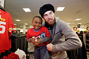 Kansas City Corporate Event and Marketing Photographer- Travis Kelce of the Kansas City Chiefs visits the JCPenney at Bolger's Square to take kids from the YMCA of Greater Kansas City on a giving spree to select holiday gifts for their family and friends, on Tuesday, Dec. 6, 2016, in Independence, Mo. The spree benefits underserved children in the Kansas City area. Photo by Colin E. Braley/JCPenney