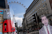 The character known as Mr Bean, one of the UK's successful TV comedy exports, looks out from a tourist trinket retailer's window in Waterloo, where the London Eye still revolves while empty during the third lockdown of the Coronavirus pandemic, on 11th March 2021, in London, England.