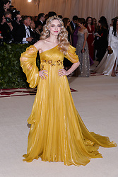 Amanda Seyfried walking the red carpet at The Metropolitan Museum of Art Costume Institute Benefit celebrating the opening of Heavenly Bodies : Fashion and the Catholic Imagination held at The Metropolitan Museum of Art  in New York, NY, on May 7, 2018. (Photo by Anthony Behar/Sipa USA)