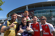 a Group of Arsenal fans from Limerick outside Emirates Stadium before k/o. Barclays Premier League, Arsenal v West Ham Utd at the Emirates Stadium in London on Sunday 9th August 2015.<br /> pic by John Patrick Fletcher, Andrew Orchard sports photography.