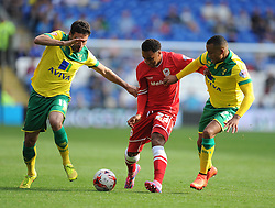 Cardiff City's Nicky Maynard battles for the ball with Norwich's Martin Olsson and Norwich's Javier Garrido - Photo mandatory by-line: Alex James/JMP - Mobile: 07966 386802 30/08/2014 - SPORT - FOOTBALL - Cardiff - Cardiff City stadium - Cardiff City  v Norwich City - Barclays Premier League