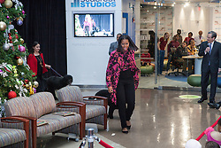 """December 12, 2016 - Washington, DC, United States - On Monday, December 12, First Lady Michelle Obama visited patients, families, and staff at Children's National Health System for the eighth consecutive year, and her last visit as First Lady, joined by TV and radio host Ryan Seacrest.....Mrs. Obama and Mr. Seacrest accompanied by First Dogs, Bo and Sunny – arrived in the hospital's Main Atrium, escorted by Santa Claus, and two patients, Maryam Noor Ashard, 13, and Abi Soliman, 5. They greeted patients, families, and staff, and as part of Mrs. Obama's annual tradition, read the holiday classic 'Twas the Night before Christmas to the audience. The children in the audience asked the First Lady and Mr. Seacrest questions. Instructors and students from Just Rock Enterprises, the Amours vocal group, and Reggie Rice–the """"Super Magic Man""""– treated children and families to a holiday concert complete with interactive songs and games.....To complete the visit, Mrs. Obama and Mr. Seacrest visited Seacrest Studios in the Main Atrium to greet additional patients and participate in an interview that was broadcasted to patients throughout the hospital. Seacrest Studios was made possible in partnership with the Ryan Seacrest Foundation (RSF). The studio provides regular programming for patients in the hospital including games, talk shows, celebrity visits, and dance parties. (Credit Image: © Cheriss May/NurPhoto via ZUMA Press)"""
