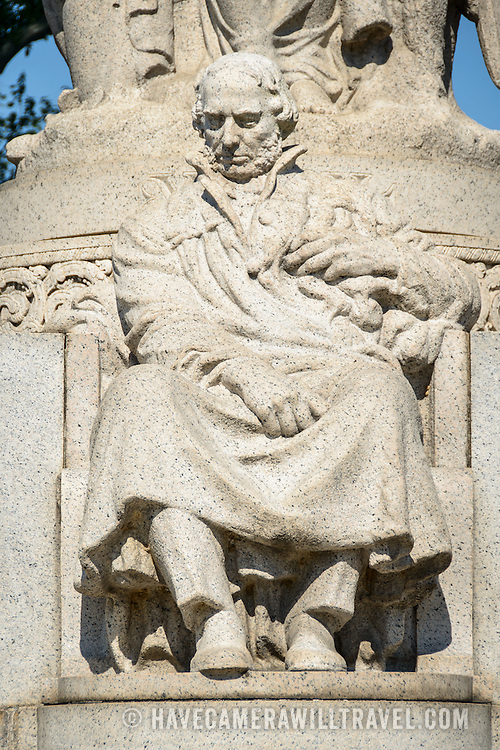 John Ericsson National Memorial Seated Figure. The John Ericsson National Memorial, on the bank of the Potomac River near the Lincoln Memorial, is a monument to Civil War naval engineer John Ericsson, the designer of the breakthrough iron-clad naval vessel USS Monitor. The memorial was designed by architect Albert Randolph Ross and sculpted by James Earle Fraser from the same pink granite used in the Lincoln Memorial. Because Ericsson was Swedish-born, the memorial consists of a combination of symbolic elements from his birthplace and his adopted homeland.