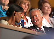 Michelle Obama and Vice Presidential candidate  Senator Joe Biden Jr. watch speakers on the second night of the Democratic Convention in Denver, Colorado. Photograph by Dennis Brack