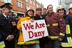 © Licensed to London News Pictures. 23/12/2019. London, UK. London Fire Commissioner (LFC), Dany Cotton (C) with members and family of the Fire Brigade on her final day in office. Hundreds of firefighters lined Union Street in London today to provide a Guard of Honour on the final day in office for London Fire Commissioner, Danny Cotton. Photo credit: Vickie Flores/LNP
