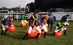 Jockeys compete in the space hopper derby during the Injured Jockeys Fund Charity Raceday at Plumpton Racecourse.