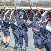 Oxford Men , Achim Harzheim, bow, Ben Landis, 2 , Patrick Sullivan, 3, Benedict Aldous, 4, Tobias Schroder, 5 , Felix Drinkall, 6 , Charlie Pearson, 7 , Augustin Wambersie, stroke , Anna Carbery, cox launching <br /> <br /> Crews prepare for Sunday's 165th Boat Race between Oxford and Cambridge, River Thames, London, Thursday 4th April 2019. © Copyright photo Steve McArthur / www.photosport.nz