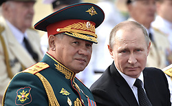 July 30, 2017 - Saint Petersburg, Russia - July 30, 2017. - Russia, Saint Petersburg. - Russian President, Supreme Commander-in-Chief Vladimir Putin and Russian Defense Minister Army General Sergey Shoigu (left) are seen here on the Admiralty Embankment in St. Petersburg as they watch the Main Naval Parade marking Navy Day. (Credit Image: © Russian Look via ZUMA Wire)