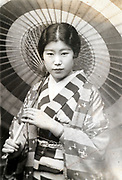 fashionable young adult woman with umbrella Japan ca 1930s 1950s