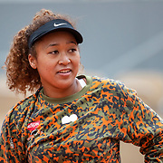 PARIS, FRANCE May 26. Naomi Osaka of Japan during practice on Court Philippe-Chatrier during a practice match against Ashleigh Barty of Australia  in preparation for the 2021 French Open Tennis Tournament at Roland Garros on May 2pm 6th 2021 in Paris, France. (Photo by Tim Clayton/Corbis via Getty Images)