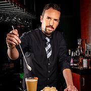 Mitchell's Ocean Club restaurant's bartender Mark Sobotkowski prepares the Hot Buttered Rum cocktail. Mitchell's Ocean Club is located at Easton Town Center. (photo by Leonardo Carrizo)