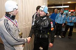 Second placed Marjan Jelenko and winner Mitja Oranic at medal ceremony after the cross country race for Slovenian National Nordic combined Championship, on January 5, 2011 at Rudno polje, Pokljuka, Slovenia. (Photo by Vid Ponikvar / Sportida.com)