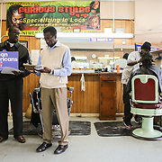 Orangeburg, SC - January 26, 2016: Field Organizer for the Hillary Clinton campaign, Reginald Abraham, meets with Henry Jenkins, owner of East End Barber Shop. Abraham hopes to further support for Clinton through endorsements by local shops and restaurants CREDIT: LOGAN R. CYRUS FOR THE NEW YORK TIMES