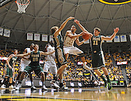 WICHITA, KS - NOVEMBER 14:  Guard Fred VanVleet #23 of the Wichita State Shockers drives to the basket between defenders Tim Rusthoven #22 and Michael Schlotman #11 of the William & Mary Tribe during the first half on November 14, 2013 at Charles Koch Arena in Wichita, Kansas.  (Photo by Peter G. Aiken/Getty Images) *** Local Caption *** Fred VanVleet;Tim Rusthoven;Michael Schlotman
