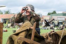 Members of the 1 Fallschirmjäger Division Green Devils living History Group take part in the first days battle re-enactment at Fort Paull. A reenactor looks for enemy threats after forcing the US 82nd to retreat from an ambush<br /> <br />   03 May 2015<br />   Image © Paul David Drabble <br />   www.pauldaviddrabble.co.uk