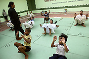 Geetan Jali Panda, 34, the wife of Biranchi Das, the recently murdered coach of Budhia Singh, is training her class in their Judo Hall, taking over her defunct husband work, in Bhubaneswar, the capital of Orissa State, on Saturday, May 17, 2008. On May 1, 2006, Budhia completed a record breaking 65 km run from Jagannath temple, Puri to Bhubaneswar. He was accompanied by his coach Biranchi Das and by the Central Reserve Police Force (CRPF). On 8th May 2006, a Government statement had ordered that he stopped running. The announcement came after doctors found the boy had high blood pressure and cardiological stress. As of 13th August 2007 Budhia's coach Biranchi Das was arrested by Indian police on suspicion of torture. Singh has accused his coach of beating him and withholding food. Das says Singh's family are making up charges as a result of a few petty rows. On April 13, Biranchi Das was shot dead in Bhubaneswar, in what is believed to be an event unconnected with Budhia, although the police is investigating the case and has made an arrest, a local goon named Raja Archary, which is now in police custody. **Italy and China Out**