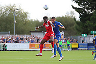 AFC Wimbledon defender Rod McDonald (26) winning header during the EFL Sky Bet League 1 match between AFC Wimbledon and Scunthorpe United at the Cherry Red Records Stadium, Kingston, England on 15 September 2018.