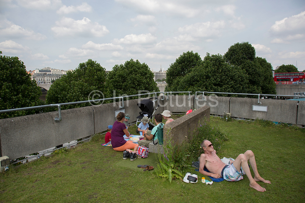 People relaxing up on the Queen Elizabeth Hall Roof Garden is an oasis at the heart of the Southbank Centre with beautiful riverside views, a cafe bar, allotments, fruit trees and wild flowers. The South Bank is a significant arts and entertainment district, and home to an endless list of activities for Londoners, visitors and tourists alike.