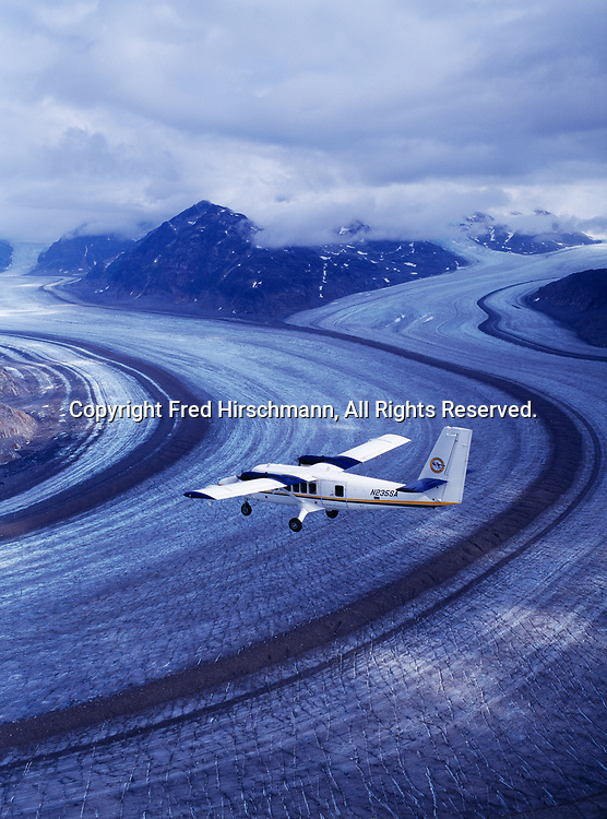 Aerial view of Seaborne Aviation's de Havilland DHC6 Twin Otter flying above the Meade Glacier, Chilkoot Range, Tongass National Forest, Alaska.