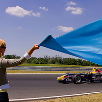 Officials wave flags signing the end of World Series by Renault Formula 3.5 race held on F1 race track Hungaroring at Mogyorod about 20km north-east from Budapest. Hungary. Sunday, 06. July 2008. ATTILA VOLGYI
