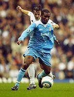 Photo: Javier Garcia/Digitalsport<br /> Tottenham Hotspur v Bolton Wanderers. FA Barclays Premiership. 23/10/2004.<br /> Jay Jay Okocha of Bolton holds off Simon Davis