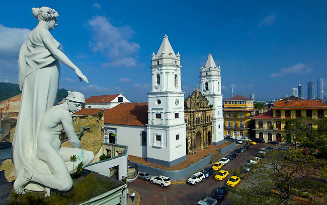 Statues on the roof of the Municipal Palace overlook the Metropolitan Cathedral and Cathedral Plaza in Casco Viejo, the neighborhood in Panama city that UNESCO declared a World Heritage Site<br />
