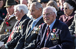 """Surviving """"Guinea pig club"""" member Des O'Connell sits with other survivors as he waits for the ceremony to unveil a new memorial to those airmen saved after being burned in their aircraft at the National Memorial Arboretum, Staffordshire."""