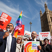 Lord Ali speaks to the crowd. The bill 'Marriage Bill 2012-13 to 2013-14'<br /> (Same Sex Couples)  has just been passed in the House of Lords to great joy for supporters outside Parliament. The bill is to to make provision for the marriage of same sex couples in England and Wales, about gender change by married persons and civil partners, about consular functions in relation to marriage, for the marriage of armed forces personnel overseas, and for connected purposes.