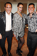 """l to r: Joel Goodrich, Jaime Jo Harris, and Mark Calvano at b.michael America Spring 2010 Collection """" Advanced American Style """" held at Christie's in Rockefeller Plaza on September 16, 2009 in New York City."""
