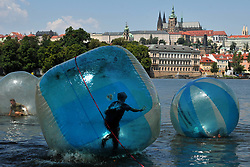 July 5, 2018 - Prague, Czech Republic - Tourists play in zorb balls on the Vltava river in Prague as temperatures reached 31 degrees Celsius. Meteorologists predict summer temperatures of around 30 degrees Celsius in the Czech Republic over coming days. (Credit Image: © Slavek Ruta via ZUMA Wire)