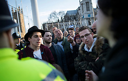 © Licensed to London News Pictures. 26/03/2018. London, UK. Young members of the Jewish community have a heated debate with supporters of Jeremy Corbyn during a demonstration outside the Houses of Parliament in London against Jeremy Corbyn, who they accuse of not acting on anti-semitic behaviour in the Labour Party. Photo credit: Ben Cawthra/LNP